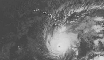 This satellite image provided by NOAA on Wednesday, Aug. 22, 2018 shows Hurricane Lane south of Hawaii