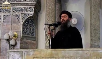 Still image taken from video of a man purported to be the reclusive leader of the militant Islamic State Abu Bakr al-Baghdadi making what would be his first public appearance at a mosque in Mosul.