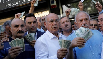 Businessmen stand in front of a currency exchange office in response to Turkish President Erdogan's call on Turks to sell their dollars  to support the lira, Turkey August 14, 2018.