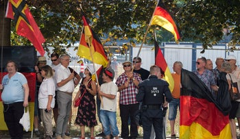 Anti-Islam Pegida movement supporters demonstrating the visit German Chancellor Angela Merkel at the Saxon state parliament, August 16, 2018.