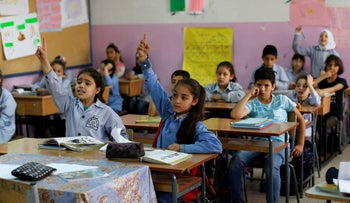 Palestinian refugees from Syria participate in an English lesson at the Jafna Elementary school, run by UNRWA, Taalabaya, Lebanon, May 22, 2018.