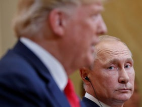 Russian President Vladimir Putin looking toward U.S. President Donald Trump during a joint press conference in Helsinki, July 16, 2018.