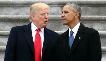 President Donald Trump talks with former President Barack Obama on Capitol Hill in Washington, June 20, 2017