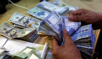 Lebanese pounds counted out at an exchange shop in Beirut, on August 20, 2018.