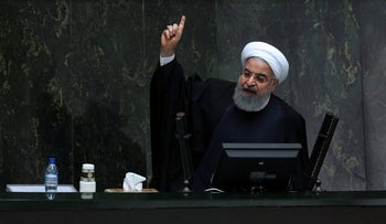 Iranian President Hassan Rouhani speaks while submitting his next year's budget bill in an open session of parliament in Tehran, Iran.