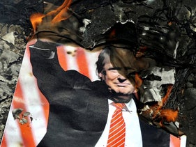 A poster of the U.S. President Donald Trump is set on fire during the annual anti-Israeli Al-Quds, Jerusalem, Day rally in Tehran, Iran. June 8, 2018