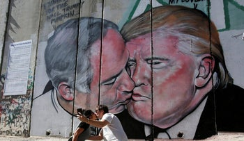 File photo: A mural depicting U.S. President Donald Trump and Israel's Prime Minister Benjamin Netanyahu kisisng each other in the West Bank city of Bethlehem.