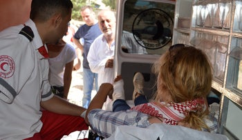 Activist Kristin Foss is taken away in an ambulance after being shot with a rubber-tipped bullet at Kafr Qaddum, August 2018.