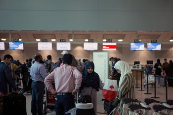 People line up to check in to the last direct flight from Toronto Pearson International Airport to Riyadh, Saudi Arabia in August 10, 2018