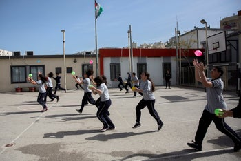 Children play with balloons at a schoool in Nablus, the West Bank.