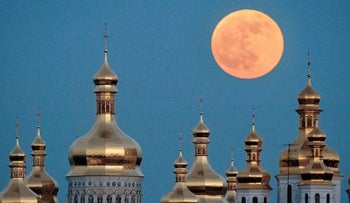 In this May 4, 2004 file photo, a full moon rises above the golden domes of the Orthodox Monastery of the Caves in Kiev, Ukraine. Ukraine is lobbying hard for a religious divorce from Russia and some observers say the issue could be decided as soon as September 2018