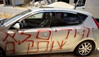 """""""Jews don't keep silent,"""" hate-crime graffiti was spray-painted on Palestinian cars in Sinjil, August 27, 2018."""