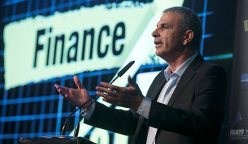 Moshe Kahlon, the Israeli finance minister, speaks during a conference in Tel Aviv.