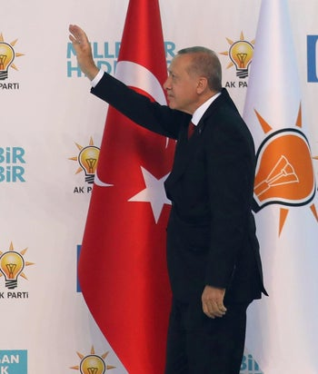 Turkish President Tayyip Erdogan waving to supporters of the Justice and Development Party during a party conference in Ankara, August 18, 2018.