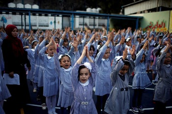 Palestinian schoolgirls participate in the morning exercise at an UNRWA-run school, on the first day of a new school year, in Gaza City August 29, 2018.