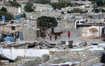 A general view shows an impoverished neighbourhood of the Khan Younis refugee camp in southern Gaza Strip on August 25, 2018