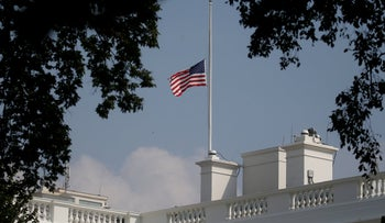 The White House flag is seen after being returned to half-mast in honor of John McCain after first being lowered, raised again and then returned to half-mast at the White House, August 27, 2018.