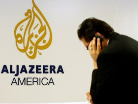 A man working at a desk in the Al Jazeera America broadcast in New York.