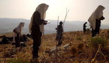Religious Israel Defense Forces soldiers praying.