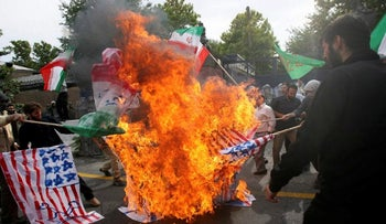 Iranian protesters burning U.S. and British flags during a demonstration in front of the British Embassy in Tehran, 2009.