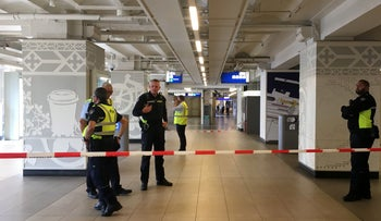 Security officials cordon off an area inside The Central Railway Station in Amsterdam on August 31, 2018