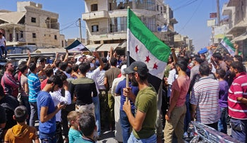 Syrians protest against the regime and its ally Russia in Syria's rebel-held northern Idlib province, August 31, 2018.
