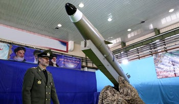 Iranian Defense Minister Amir Hatami next to the next generation short-range ballistic missile 'Fateh Mobin' during an unveiling ceremony in Tehran, August 2018.