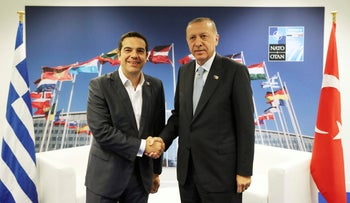 Turkey's President Recep Tayyip Erdogan shakes hands with Greece's Prime Minister Alexis Tsipras at the NATO headquarters in Brussels, July 12, 2018.