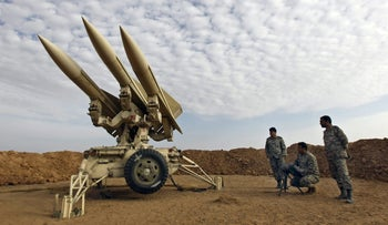 File photo: Iranian army members prepare missiles to be launched, during a maneuver, Iran, November 13, 2012