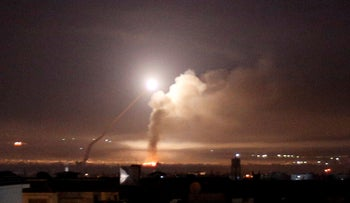 FILE PHOTO: Missile fire is seen from Damascus, Syria May 10, 2018.