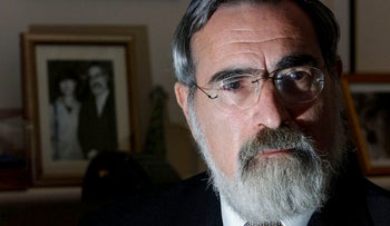 File photo: Britain's former Chief Rabbi Dr Jonathan Sacks is seen speaking during an interview at his home in London in this file photo from April 17, 2002