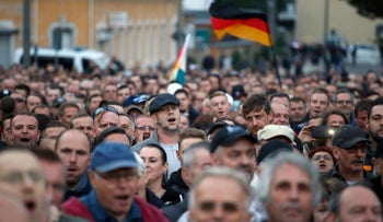 """The far-right group """"Pro Chemnitz"""" stages an anti-immigrant protest in Chemnitz, eastern Germany, August 30, 2018."""