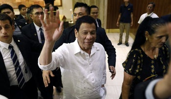 The president of the Philippines Rodrigo Duterte waves upon his arrival in Jerusalem at the start of an official visit to Israel, September 2, 2018.
