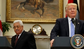 File photo: U.S. President Donald Trump and behind him Palestinian President Mahmoud Abbas as the two arrive in the Roosevelt Room of the White House.