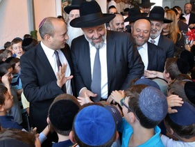 Education Minister Naftali Bennett and Interior Minister Arye Dery, with Shas pupils on the first day of a new school year, August 2018.