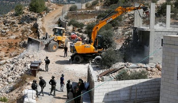 An Israeli machinery demolishes a Palestinian house in the village of Al-Walaja near Bethlehem, in the occupied West Bank September 3, 2018.