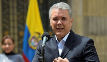 Colombian President Ivan Duque speaks after voting during a popular consultation on measures including cutting congressional salaries and boosting sentences for corruption, in Bogota on August 26, 2018.