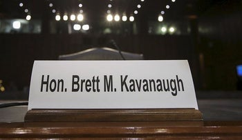 A nameplate for Judge Brett Kavanaugh sits on the desk where he will testify before Senate Judiciary Committee during his Supreme Court confirmation hearing in the Hart Senate Office Building on Capitol Hill, September 4, 2018 in Washington, DC.