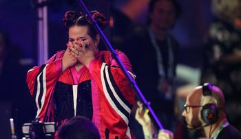Netta from Israel reacts as she wins the Eurovision Song Contest grand final in Lisbon, Portugal, Saturday, May 12, 2018