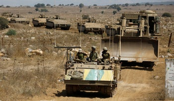 Israeli armored vehicles take part in an army drill during a visit of Israeli Defense Minister Avigdor Lieberman in the Golan Heights, Israel, August 7, 2018.