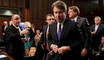 Fred Guttenberg (L), the father of Jamie Guttenberg, a victim of the February 14, 2018 mass shooting in Parkland, Florida, reaches out to try to shake hands with U.S. Supreme Court nominee Judge Brett Kavanaugh during his U.S. Senate Judiciary Committee confirmation hearing on Capitol Hill in Washington, U.S., September 4, 2018