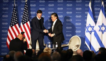 Jared Kushner, senior White House adviser, left, shakes hands with billionaire Haim Saban, chairmand and chief executive officer of Saban Capital Group Inc., during the Brookings Saban Forum in Washington, D.C., U.S.