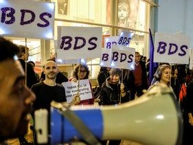 Supporters of the BDS movement at the end of a demonstration against government corruption at Habima Square, Tel Aviv