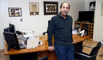 Rami Levy, founder and chief executive officer of Rami Levi Chain Stores Hashikma Marketing 2006 Ltd.,  poses for a photograph at his company headquarters in Jerusalem, Israel.