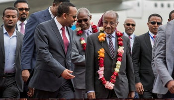 Eritrea's Foreign Minister Osman Sale, is welcomed by Ethiopia's Prime Minister Abiy Ahmed, center left, upon the Eritrean delegation's arrival at the airport in Addis Ababa, Ethiopia, June 26, 2018