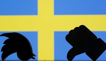 3D-printed Twitter and Facebook logos are seen in front of a displayed Sweden flag in this illustration picture, September 5, 2018.