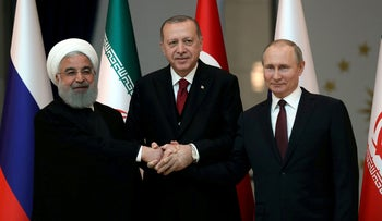 FILE PHOTO: Presidents Hassan Rouhani of Iran, Tayyip Erdogan of Turkey and Vladimir Putin of Russia pose before their meeting in Ankara, Turkey April 4, 2018.