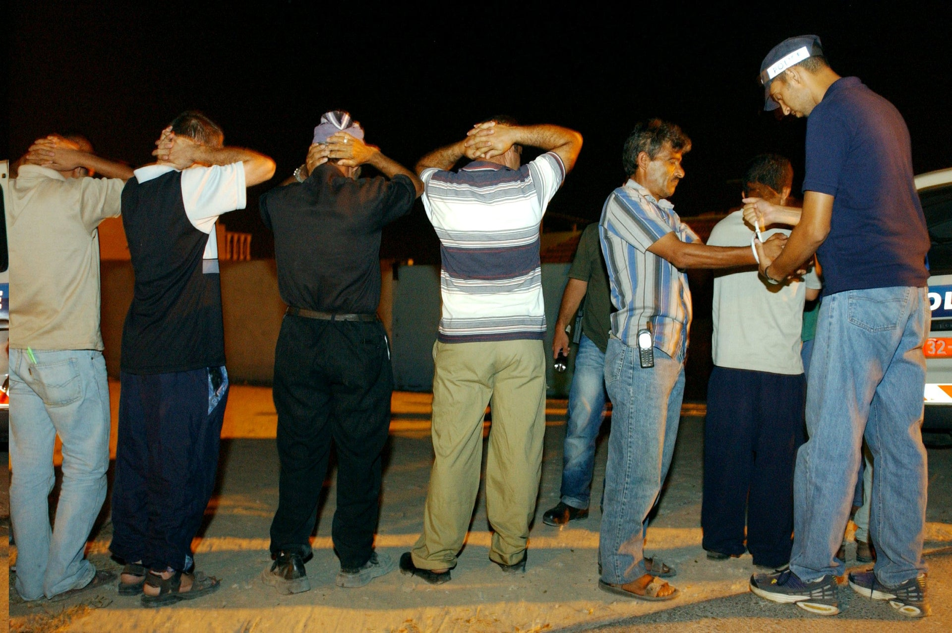 Palestinians without work permits arrested in Lod in central Israel in 2002