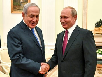 Prime Minister Benjamin Netanyahu shaking hands with President Vladimir Putin during their meeting at the Kremlin in Moscow, July 11, 2018.