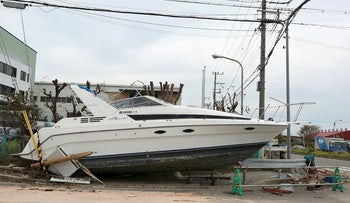 A boat sits grounded on a sidewalk in Nishinomiya, Hyogo Prefecture, Japan, on Thursday. Sept. 6, 2018